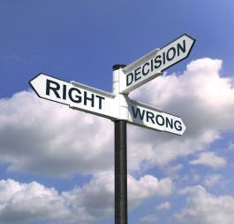 Concept image of a signpost with Decision Right or Wrong against a blue cloudy sky